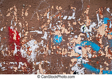 fragments of posters on old wall, signs of graffiti,...