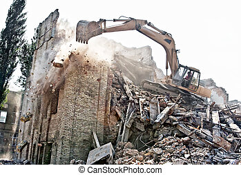 Demolition of old building - Excavator demolishing of an old...