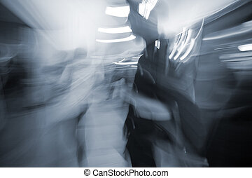blurred motion people commuting in the underground station...