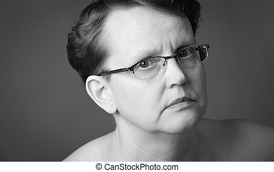 Sad face - Sad 50 year old woman, close-up black and white...