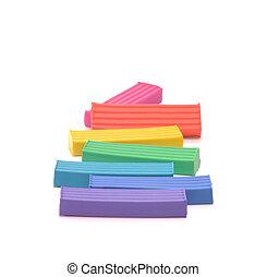 Plasticine - Seven pieces of plasticine which are located on...