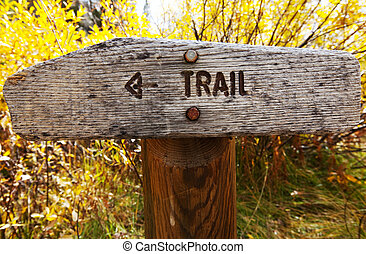 Trail - Sign points to a hiking trail