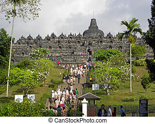 Borobudur Temple - MAGELANG, INDONESIA - JULY 4: Group of...