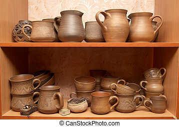 Old clay pots - Many handmade old clay pots on the shelf