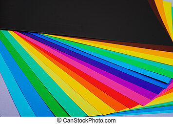various color paper stacks background