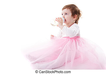 Girl is drinking from bottle isolated