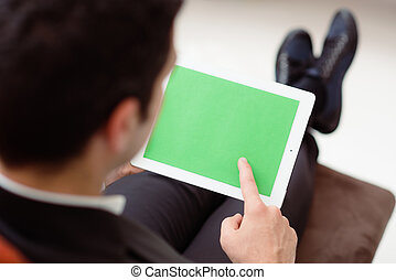 Businessman using computer with green screen for web and...