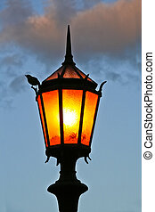 Streetlamp - Lit old streetlamp at sunset in Argentine