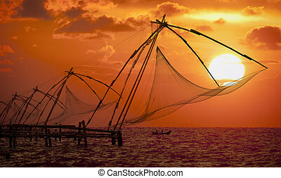 Sunset over Chinese Fishing nets in Cochin - Sunset over...