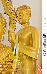 Golden Buddha statue in the ancient church