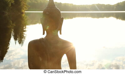 Buddha Sunrise. Closeup. - Closeup of sculpture of a Buddha...