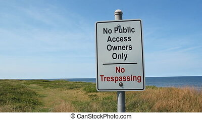 No public access. Owners Only. Sign near beachfront...