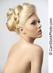 blonde hair style, the girl looks up - very pretty blonde...
