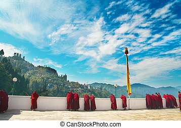 Monks from indian monastery - Monks in red robes in the...