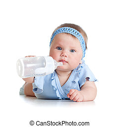 adorable child drinking from bottle. 8 months old girl.