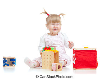 funny baby girl playing with color educational toy