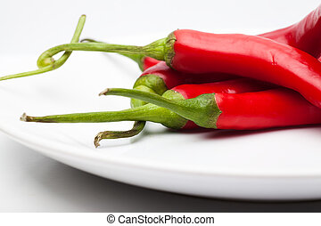 Red chili peppers - Closeup view of red chili peppers on a...