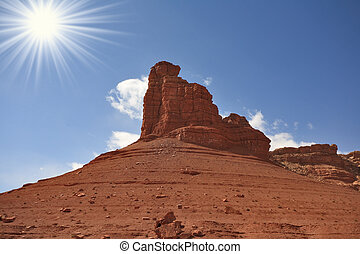 A grandiose rock from red sandstone - Monument Valley in the...