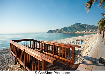 Beach promenade - Wooden walkway to access a sunny...