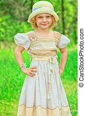 country style - Portrait of a cute little girl having a rest...
