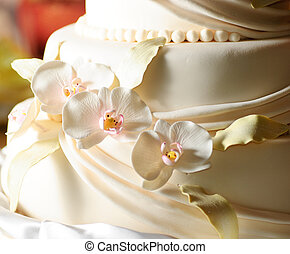 Wedding cake with white icing and orchids
