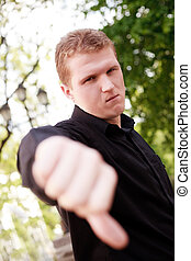 thumb down! - Blonde man outdoor with thumb down