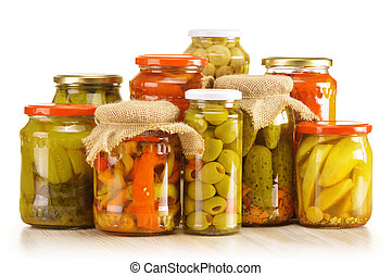 Composition with jars of pickled vegetables. Marinated food....