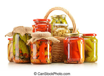 Composition with wicker basket and jars of pickled vegetables.