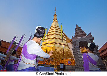 Girls are local dance for holy day ceremony in Buddhism.