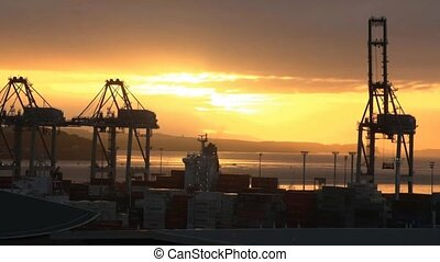 Auckland sunrise over the port. - Sunrise over Auckland...