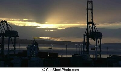 Sunrise over Auckland port. - Sunrise over Auckland harbour...