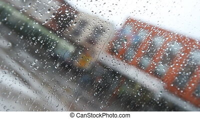 Rainy city window. Defoc bground. - Rainstorm in the city....