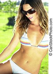 young woman in striped bikini and sunglasses - Beautiful...