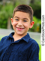Happy latino child smiling with missing tooth