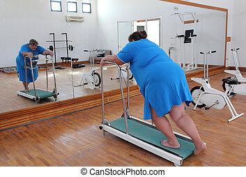 overweight woman running on trainer treadmill - fitness -...