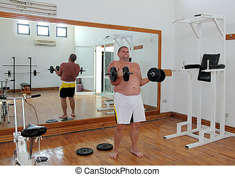 fun man with dumbbells