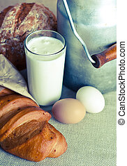 Close up of healthy products includes milk, eggs and bakery