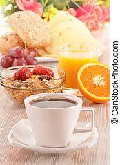 Breakfast on the table. Coffee, orange juice, rolls, muesli.
