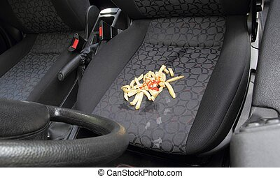 Messy French fries spilt on car seat - Messy French fries or...