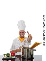 Chef in his toque giving a thumbs up of approval a he stands...