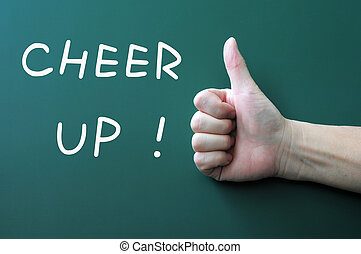 Cheer up written on a blackboard background with a thumb up