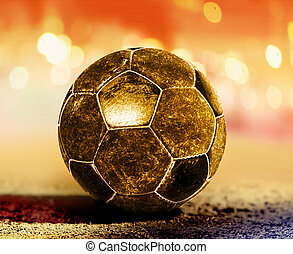 golden ball on ground - golden soccer ball on ground of...