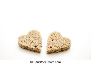Rye bread in heart form on white background
