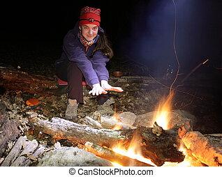 Girl near campfire - Girl near camping fire