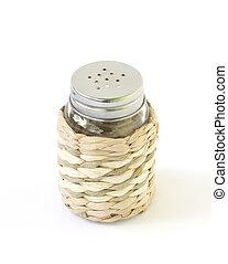 Salt shaker over white