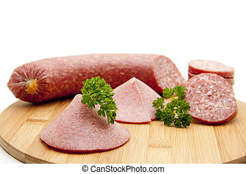 Garlic sausage on wooden plate - Garlic sausage with parsley...