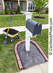 Mailbox Renovation - Laying mulch around the mailbox and...