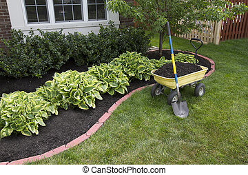Mulching around the Bushes - Mulching bed around the house...