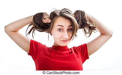 Young woman playing with her ??hair