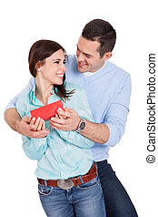 Young man giving present to his girlfriend